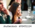 blurred people in the banquet... | Shutterstock . vector #693451114