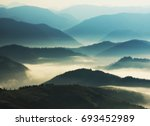 silhouettes of mountains. a... | Shutterstock . vector #693452989