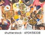 vegetarians share baked... | Shutterstock . vector #693458338