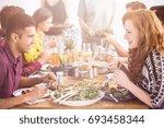 handsome man enjoys tasty...   Shutterstock . vector #693458344
