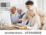 elder lady with glasses helping ... | Shutterstock . vector #693468808