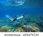 young snorkel swims underwater. ... | Shutterstock . vector #693474724