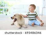 cute child with labrador... | Shutterstock . vector #693486346