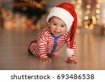 Cute Little Baby With Santa Ha...