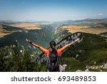 hiker woman spreading her hands ... | Shutterstock . vector #693489853