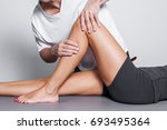 physiotherapy leg massage in... | Shutterstock . vector #693495364