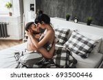 guy and girl making love in bed....   Shutterstock . vector #693500446
