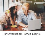 man and woman sitting in a... | Shutterstock . vector #693512548