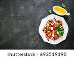 caprese salad. mozzarella... | Shutterstock . vector #693519190