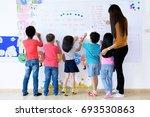 teachers and children in... | Shutterstock . vector #693530863