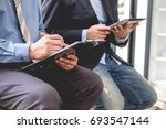 business people meeting time.... | Shutterstock . vector #693547144