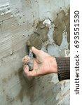 Small photo of Plasterer plaster wall plaster