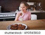 little sweet girl eating... | Shutterstock . vector #693565810