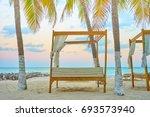 luxurious beach lounge at isla... | Shutterstock . vector #693573940
