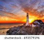 Lighthouse On The Beach At...