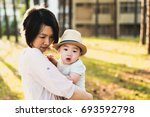 happy family  mom and cute baby ... | Shutterstock . vector #693592798