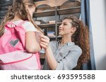 beautiful young mother...   Shutterstock . vector #693595588