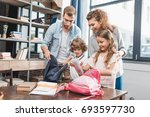 parents packing kids for their... | Shutterstock . vector #693597730