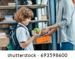 mother giving school lunch to... | Shutterstock . vector #693598600