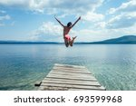 the girl in a swimsuit is... | Shutterstock . vector #693599968