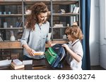 adorable young mother and son... | Shutterstock . vector #693603274