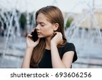 woman talking on the phone in... | Shutterstock . vector #693606256
