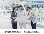 three people are business... | Shutterstock . vector #693608053