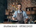 happy young man with apron... | Shutterstock . vector #693611410