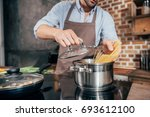cropped shot of man with apron... | Shutterstock . vector #693612100