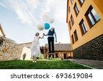 stylish happy bride and groom...   Shutterstock . vector #693619084