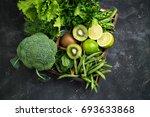green vegetables background.... | Shutterstock . vector #693633868