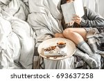 cute girl on a comfortable... | Shutterstock . vector #693637258