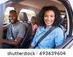 young black family in a car on... | Shutterstock . vector #693639604