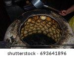 samsa baked in tandoor | Shutterstock . vector #693641896
