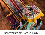 peruvian woman weaving colorful ... | Shutterstock . vector #693645370