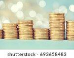 stacks of golden coins  euros  | Shutterstock . vector #693658483