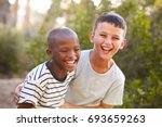 Portrait Of Two Boys Embracing...
