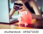 pink color pig save bank with... | Shutterstock . vector #693671020