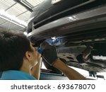 car mechanic man  put on gloves ... | Shutterstock . vector #693678070