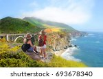 friends on hiking trip looking... | Shutterstock . vector #693678340