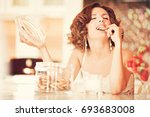 beautiful young woman eating...   Shutterstock . vector #693683008