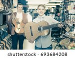 man and a boy show acoustic... | Shutterstock . vector #693684208