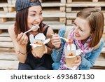 two girls friends enjoying a... | Shutterstock . vector #693687130