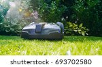robotic lawn mower mows the... | Shutterstock . vector #693702580