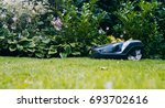 robotic lawn mower mows the... | Shutterstock . vector #693702616