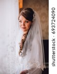 bride on silk robe looking on... | Shutterstock . vector #693724090