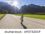 little boy running on street... | Shutterstock . vector #693732019
