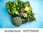green vegetables background.... | Shutterstock . vector #693733630