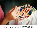 woman doing embroidery portrait ... | Shutterstock . vector #693738736