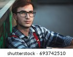 young man sitting at skate park ... | Shutterstock . vector #693742510
